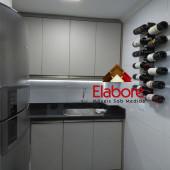 Cozinha com lavanderia e granito na cor Verde Labrador