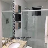 Banheiro com nichos decorativos em mdf